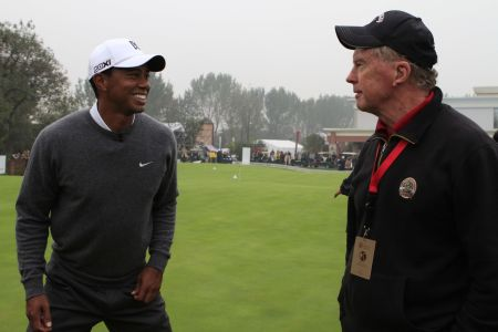 Bernie and Tiger Woods chatting at the 2012 Battle of Lake Jinsha in China.