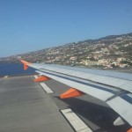 Easyjet flight taxing with view of Madeira Island coastline