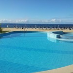 Swimming pool of Madeira Regency Club hotel with Atlantic Ocean backdrop
