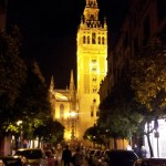 The Seville Cathedral dominates the night skyline