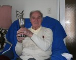Kel Nagle - Golf's oldest living Major Champion at his home in Sydney with the Claret Jug he won in winning the 1960 Centenary Open Championship at St. Andrews.  (Photo - www.golfbytourmiss.com)