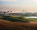 Saadiyat Beach GC with Abu Dhabi skyline in background