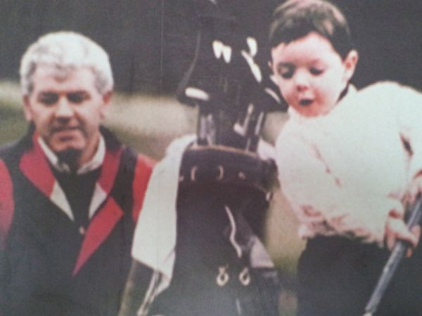 A photograph of young Rory McIlroy and his father that is on display at the Holywood Golf Club.