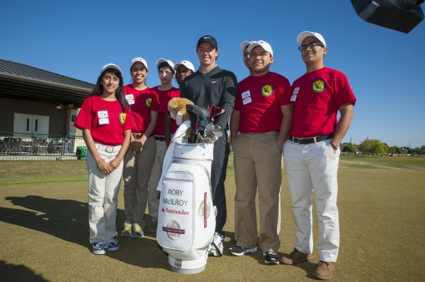 Rory McIlroy and Chinquapin Prep school students.  (Photo - Shell Houston Open)