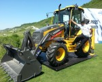 Thongchai climbs aboard the Euro 55,000 Volvo Backhoe loader on offer for an ace at the par three, 7th hole