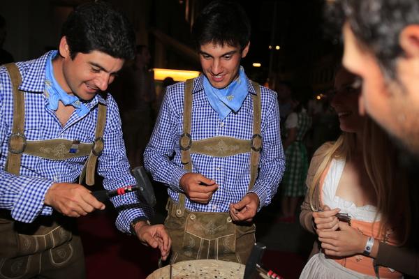 Chilean Felipe Aguilar and Matteo Manassero at a nail hitting contest.