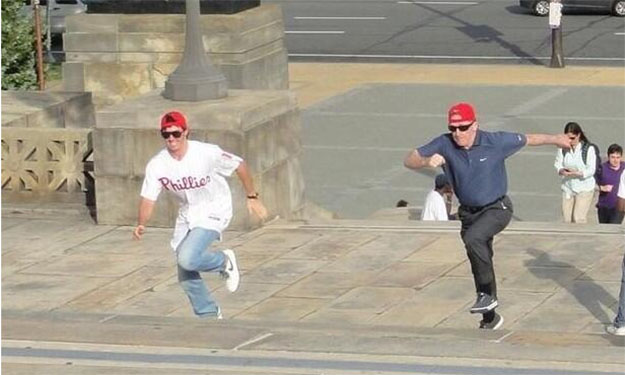 Rory McIlroy races long-time coach Michael Bannon up the 'Rocky' steps in Philadelphia.  (Photo - Rory McIlroy)