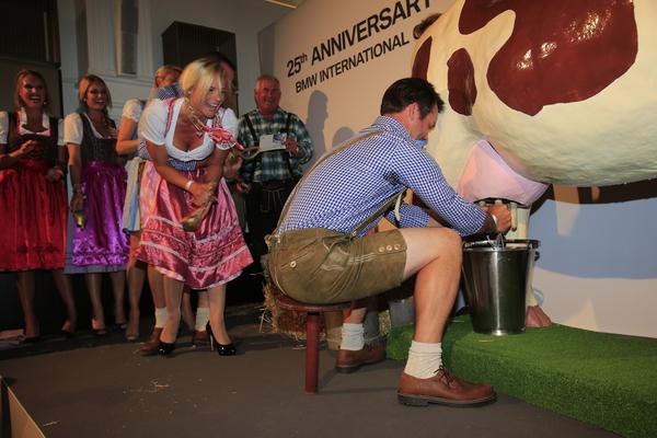 Pollyanna Woodward gets behind boyfriend, Paul Casey in the cow-milking contest.