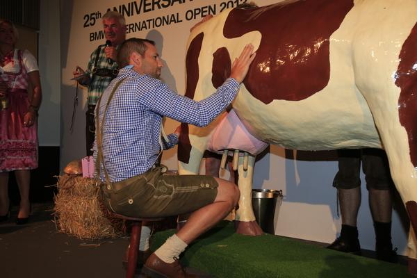 Sergio Garcia tries to calm the mechanical cow.