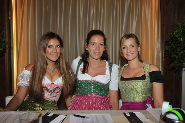 Young German ladies present to greet guests