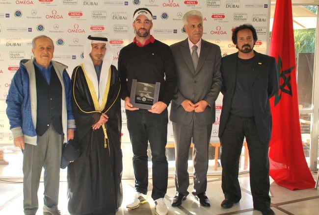 Heshan Al Qassim, CEO and vice chairman of wasl, presenting the winner's trophy to Zane Scotland as Mohamed Juma Buamaim, chairman of the MENA Golf Tour, Mustafa Al Hashimi, general manager of Dubai Creek Golf Club, George Horan, the club captain, and Chris May, CEO of Dubai Golf, look on
