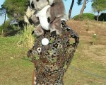 Bernie's Koala resting atop a bust on the 16th tee.