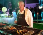 Monty cooking up a storm and the bar-b-que he hosted Saturday night.  (Photo - www.golfbytourmiss.com)