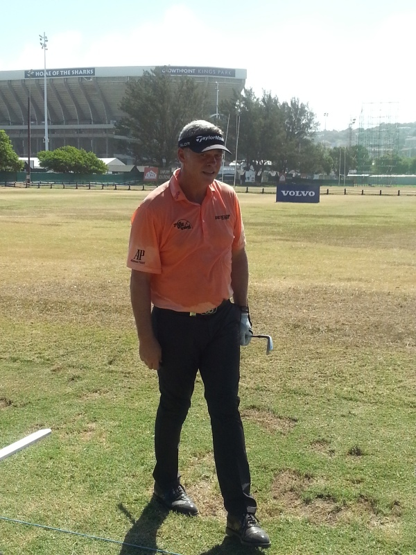 NOW - Darren Clarke sweats it out on the practice range in the shadow of the Sharks Super-14 home ground.(Photo - www.golfbytourmiss.com)