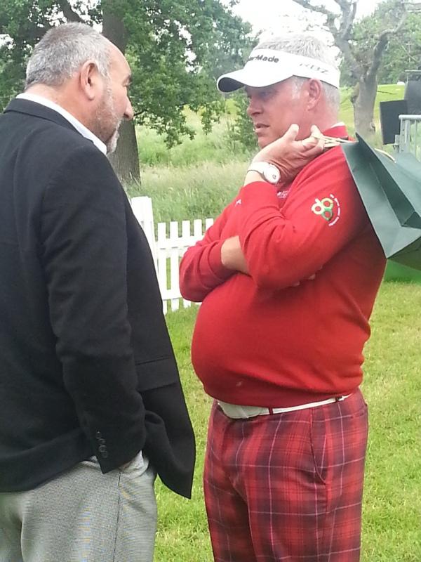 BEFORE - Darren Clarke chatting with Chubby Chandler during last June's Irish Open.  (Photo - www.golfbytourmiss.com)