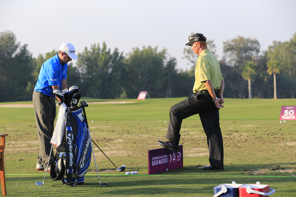 New coach Jamie Clough watches over Peter Lawrie on the Doha Club practice range.  (Photo - Eoin Clarke/www.golffile.ie)