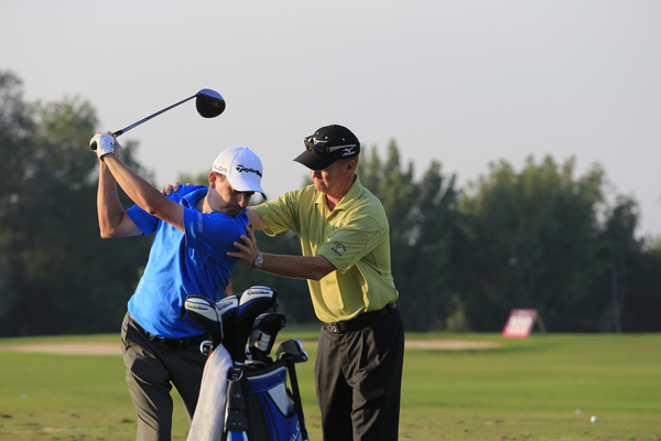 Peter Lawrie and his new coach, Jamie Gough on the range during Friday's Round 3 of the Commercial Bank Qatar Masters 2014 held at Doha Golf Club, Doha, Qatar. 24th January 2014. Picture: Eoin Clarke www.golffile.ie