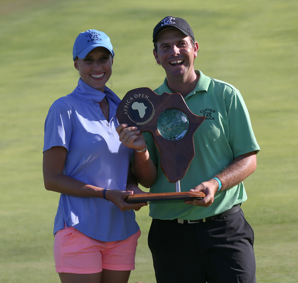 Thomas Aiken and his caddying wife Kate celebrate victory in the Africa Open.  (Photo - www.golffile.ie)