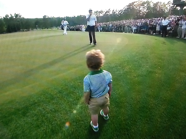 Bubba's son Caleb strolls  out to greet his father.