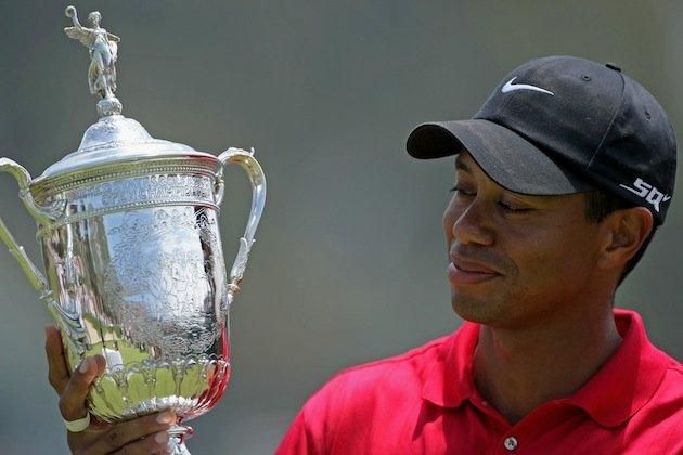 Tiger Woods admires the U.S. Open trophy - his last Major success in 2008 at Torrey Pines.
