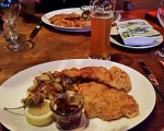 Makes you mouth water just looking at this snap - two pieces of schnitzel and a Weiss beer.