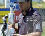 Graeme McDowell gets his hands on the Claret Jug ahead of his successful defence on the 2014 French Open.