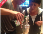 Harry Diamond, and one of Rory McIroy's closest friends, pours Jagermeister into the Claret Jug as Rory's mum, Rosie looks on.