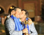Victorious European Captain Jose Maria Olazabal plants a kiss on England's Lee Westwood after winning 2012 Ryder Cup. (Photo - Colum Watts/www.golffile.ie)
