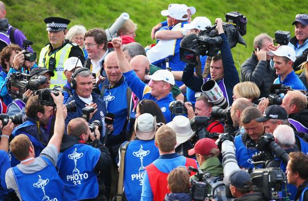 Welsh wonder Jamie Donaldson mobbed after  securing Europe victory in the Ryder Cup. (Photo - www.golffile.ie)