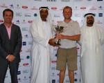 Luke Joy, the winner of the ASCORP GOLF CITIZEN Abu Dhabi Open, with Khalfan Al Kaabi, a Board member of the Emirates Golf Federation, Mohamed Juma Buamaim, chairman of the MENA Golf Tour, and  Paul Booth, Director of Club Operations at Saadiyat Beach Golf Club.
