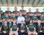 Ernie Els shows his love of South African sport and seen here proudly sitting with the mighty Springboks.