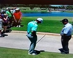Rory gets  ruling at the back of the 3rd green with his ball still on the cart path.
