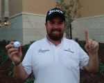 Shane Lowry proudly showing the ball he used to secure his first ace on Tour.  (Photo - www.golfbytourmiss.com)