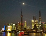 Shanghai is a splash of colour as darkness falls.