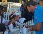 The young girl is now the proud owner of Graeme McDowell's cap.  (Photo - www.golfbytourmiss.com)