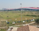 Looking over the practice range with Ferrari World unmistakable in the background
