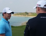 Rory McIlroy and Stephen Gallacher chatting often during the round on the Yas Links course.