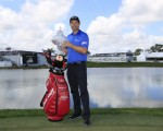 Padraig Harrington delivers some timely advice to Tiger Woods after capturing a second Honda Classic title.  (Photo - Fran Caffrey/www.golffille.ie)