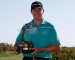 Local hero Jimmy Walker with the very heavy Valero Texas Open trophy.  (Photo - www.pgatour.com)
