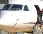 Tiger Woods emerging from his private jet.