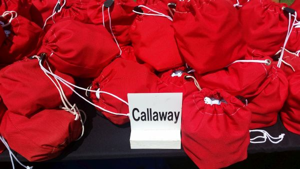 Bags and bags of state-of-the-art Callaway balls on the Golf Club of Houston practice range.
