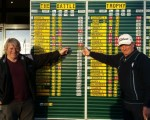 Crail members George Morris (left) and Rob Redpath admiring Conor Syme's impressive rounds of 64 and 67 in the 2015 Battle Trophy.