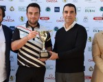 Scotland's Paul Doherty receiving the winner's trophy from Hicham Gherbi, secretary-general of Royal Golf D'Anfa Mohammedia, as Mohamed Juma Buamaim, chairman of the MENA Golf Tour, and Imad Boufarik, director of Royal Golf D'Anfa Mohammedia, look on