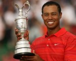 Tiger Woods lifts the Claret Jug for a first time and winning by a massive eight shots in 2000 at St. Andrews.