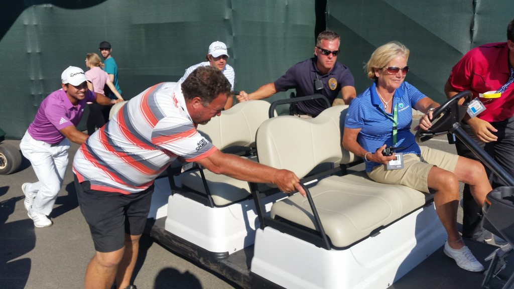 Newly-crowned PGA Champion Jason Day admits pushing this broken down cart on Tuesday didn't help his back.