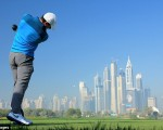 Rory McIlroy tees off the 8th hole at the Emirates Club course and hole used in Omega TV ad.