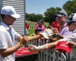 Jordan Speith signing autographs after his round of 71.