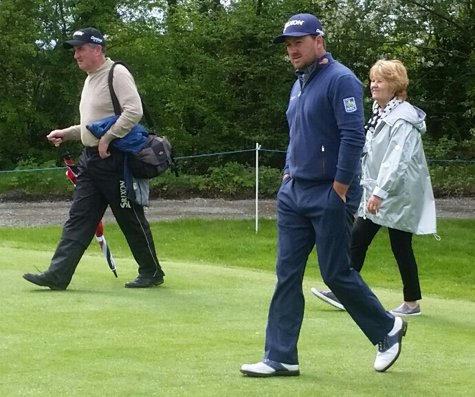 G Mac with his coach, Clive Tucker and his mum walking the K. Club course.