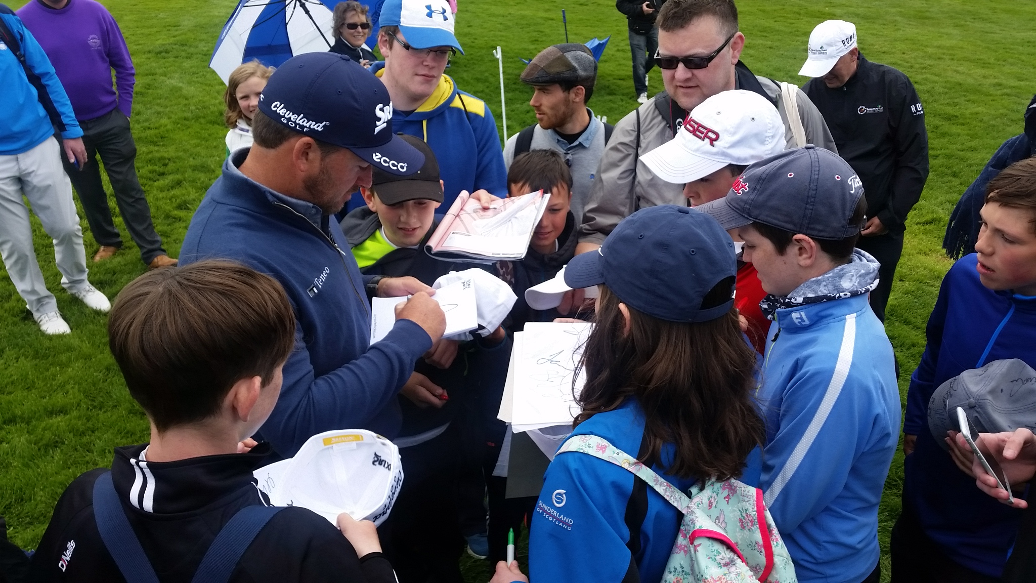 G Mac signing a few more autographs after his Pro-Am round