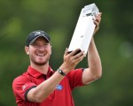 England's Chris Wood proudly lifts the BMW PGA  Trophy.
